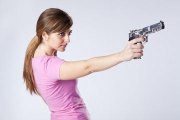 Woman aiming a handgun