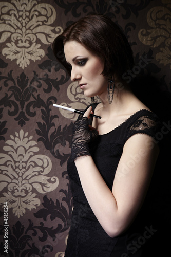 Nice lady model posing as a cigarette smoker