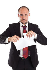 Businessman tearing paper