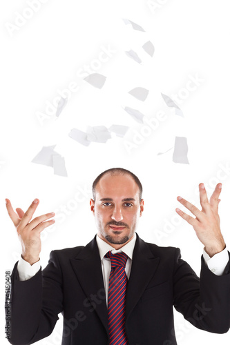 Businessman tearing and trowing paper