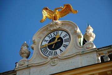 Clock on Schönbrunn castle, Vienna, Austria