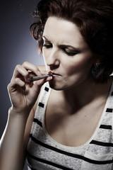 Young beauty smoking marijuana