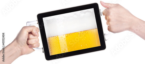 hands holding tablet computer with beer