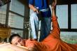 Young woman having thai massage