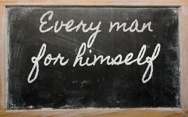 expression -  Every man for himself - written on a school blackb
