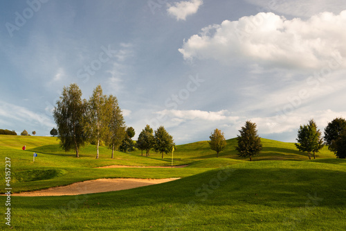 Sand bunkers on the golf course at sunset, Prague