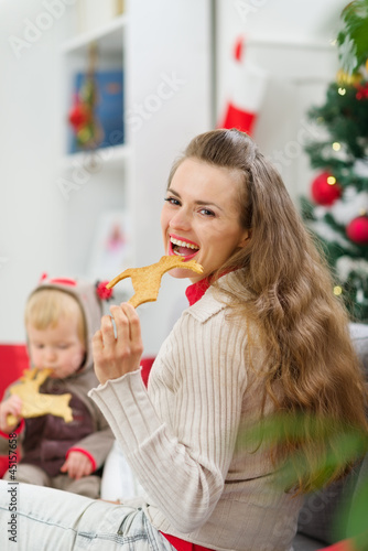 Mother and baby eating Christmas deer shaped cookies