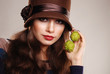 Brunette model in hat with chestnuts