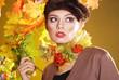 Colorful autumn portrait of beautiful brunette model