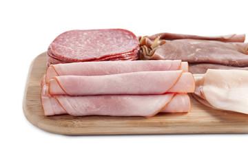 ham in wooden plate