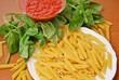 pasta maccaroni tomato and basil leaf