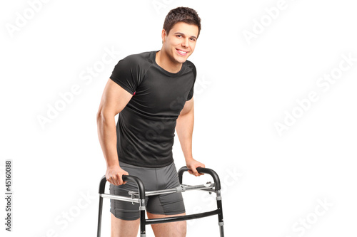 A young smiling athlete using a walker