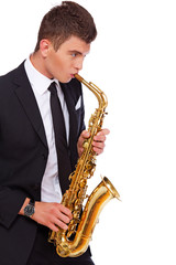 A young musician with a saxophone