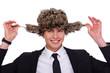 A businessman wearing a fur hat