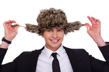 A businessman wearing a fur hat