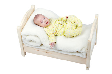 baby in wooden crib