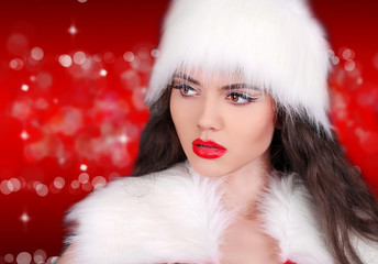 Santa girl with red lips looking away on red bokeh abstract