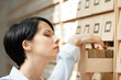 Woman searches something in card catalog