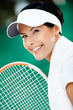 Close up of successful tennis player with towel on her shoulders