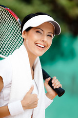 Successful female tennis player with towel