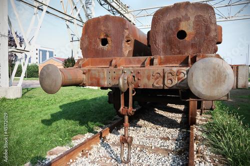 rusty train on rails