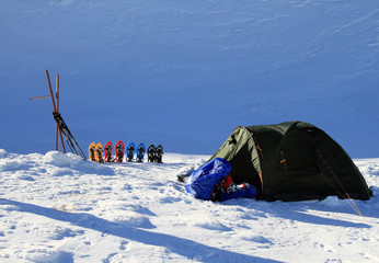Tent in winter mountain.