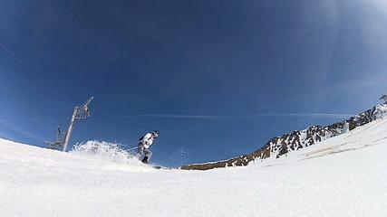 Downhill skier performing a maneuver