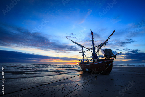 silhouette of fishermen with sunrise in the background