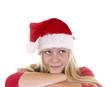 Hübsches Mädchen mit Nikolausmütze – nachdenklich