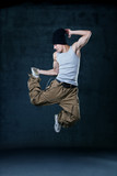Young hip-hop dancer jumping