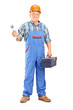Manual worker holding a wrench and tool box
