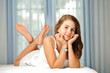 Portrait of smiling beautiful teen girl at home in white dress a