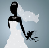 Silhouette of a beautiful bride standing and holding a bouquet.