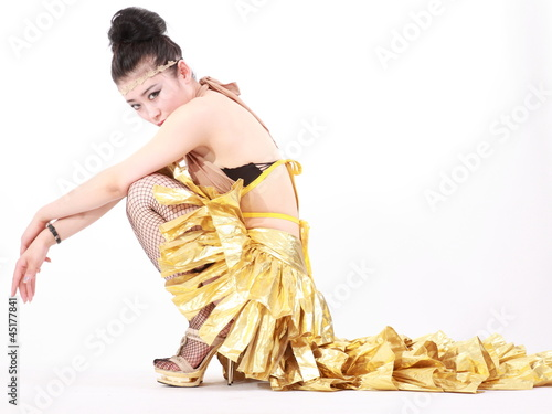 woman in various dance costumes and fun poses