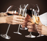 Fototapety People holding glasses of white wine making a toast