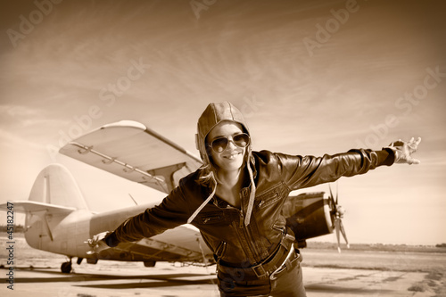 Happy young woman with raised hands  flying on airporte,