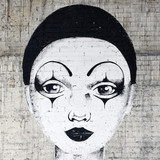 Fototapety White faced clown graffiti on a brickwall