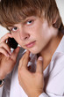 Close up of young handsome man talking on mobile phone against w
