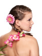 Pretty young woman with pink flower side and back - isolated