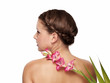 Pretty young woman with pink flower back - isolated