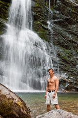 young man and waterfall