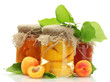 canned apricots and jam in a jars with sweet apricots isolated