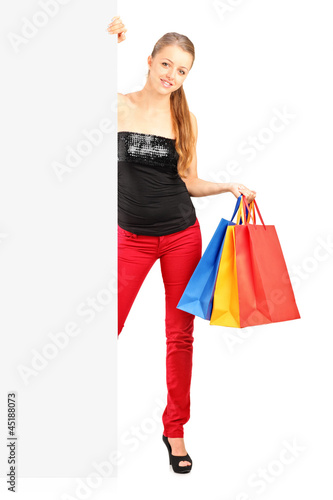 Smiling woman holding a shopping bags