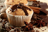 Fototapety tasty muffin cakes with chocolate, spices and coffee seeds,
