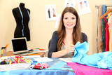 Fototapety beautiful young dressmaker in workroom