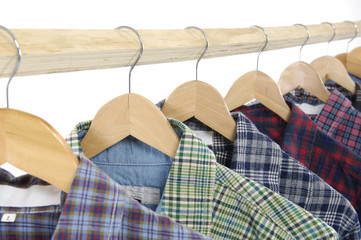colors short sleeved plaid cotton on a  wooden hanger