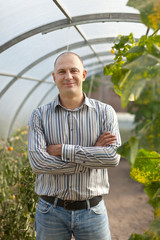 man in greenhouse