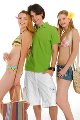 Three friends in beach clothing, going on vacation. Studio shot,