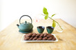 japanese tea with chocolate biscuits on wooden table