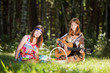 Hippie girls with a fruit basket